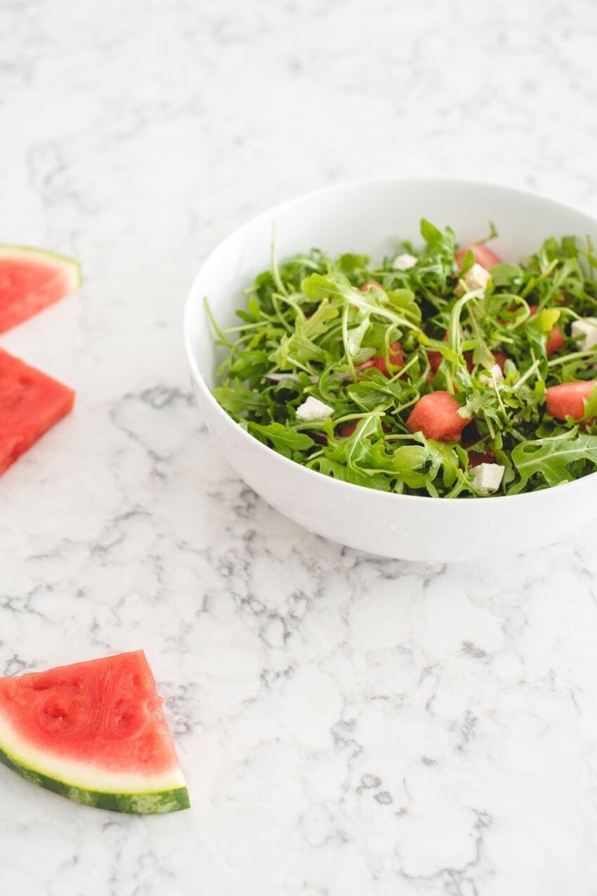 I love watermelon - it's my favourite summertime fruit! In this recipe, you get the sweetness of watermelon paired perfectly with the bitterness of arugula. Check out this simple and delicious summertime salad recipe! #watermelonsalad #watermelonsaladrecipes #summersalads #tulipandsage