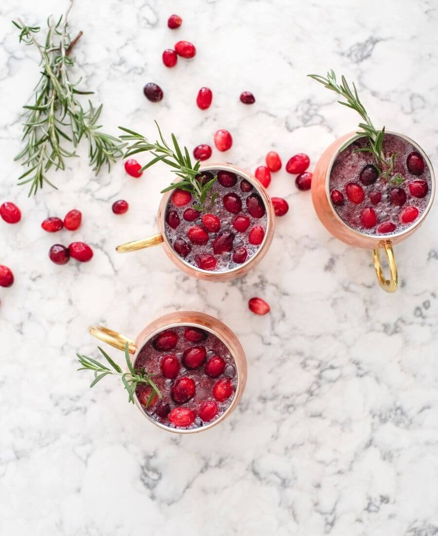 This Cranberry Moscow Mule is the perfect festive cocktail to enjoy this New Year's Eve.  It's super simple to make and really delicious. #moscowmule #moscowmulerecipe #cranberrymoscowmule #cranberrymoscowmulerecipe