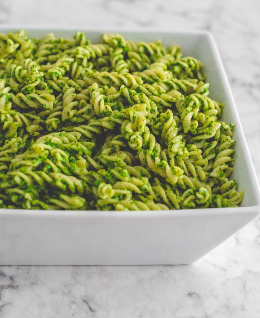 Calling all Pesto Lovers! Here's an Arugula Pesto Pasta recipe that is delicious and so easy to make! Enjoy it as is or with chicken or shrimp. #arugulapestopasta #arugulapesto #arugulapestovegan #pastarecipes #tulipandsage