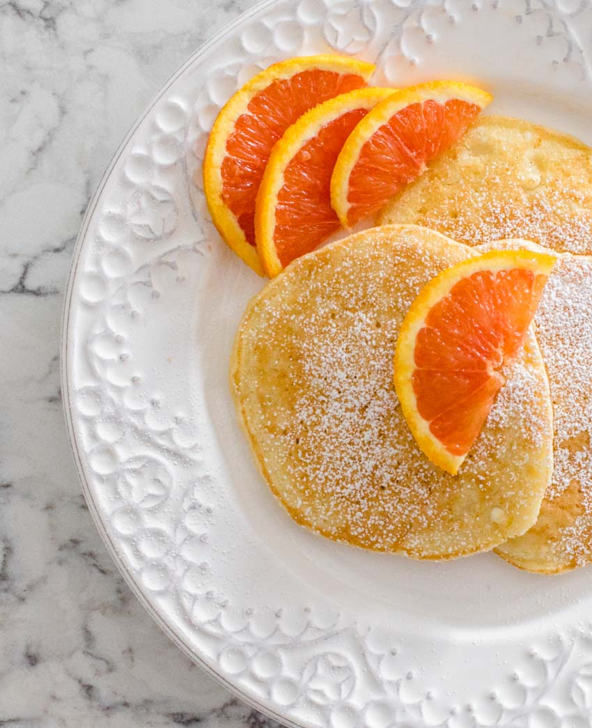 If you're in the mood for fluffy, delicious pancakes with the yummiest hint of fresh orange flavour, you will LOVE these Orange Ricotta Pancakes! #orangericottapancakes #orangericottapancakesrecipe #pancakerecipe #pancakesfromscratch #pancakes #tulipandsage