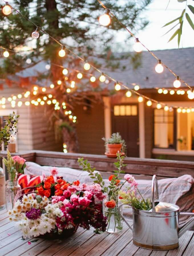 sourcec - domesticimperfection.com/ Outdoor spaces and string lights are a pair made in summertime heaven!  Here are some magical summertime string light spaces to make you smile! #outdoorstringlights #outdoorstringlightsideas #stringlights #outdoorsummerstringlights #summerstringlights #tulipandsage