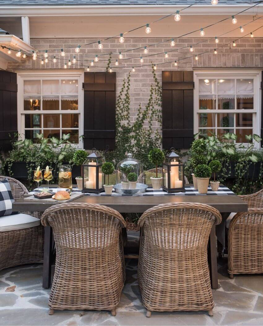 source - lavinlabel.com/ Outdoor spaces and string lights are a pair made in summertime heaven!  Here are some magical summertime string light spaces to make you smile! #outdoorstringlights #outdoorstringlightsideas #stringlights #outdoorsummerstringlights #summerstringlights #tulipandsage