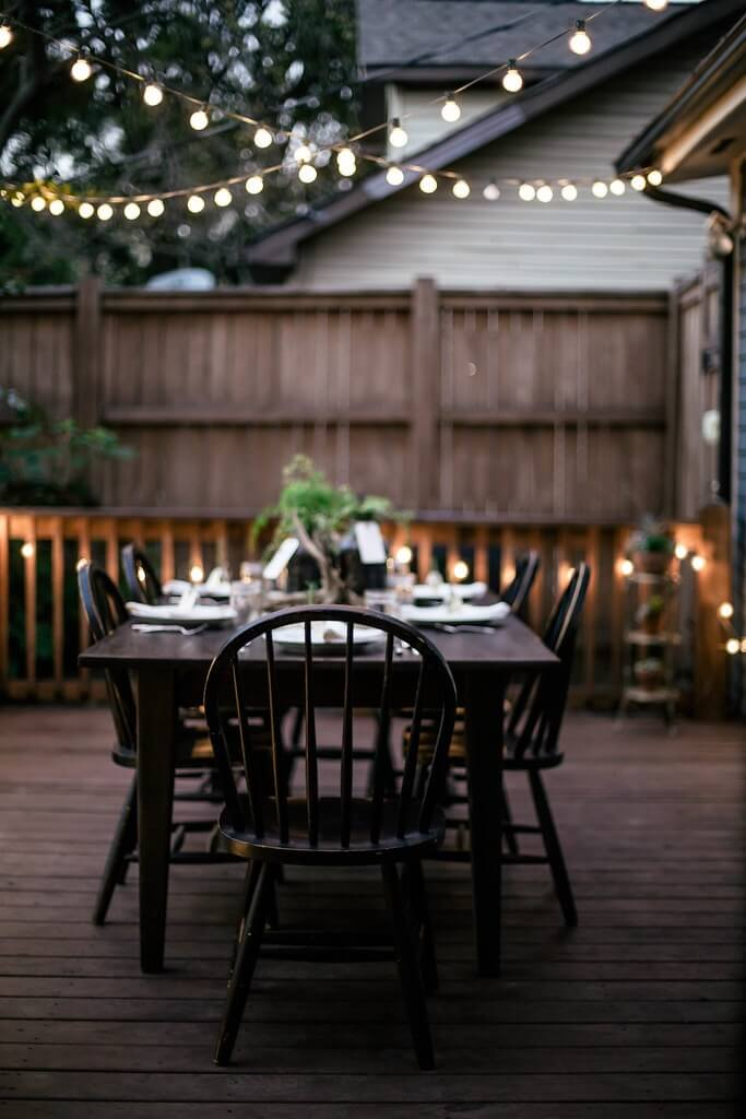 source - localmilkblog.com/ Outdoor spaces and string lights are a pair made in summertime heaven!  Here are some magical summertime string light spaces to make you smile! #outdoorstringlights #outdoorstringlightsideas #stringlights #outdoorsummerstringlights #summerstringlights #tulipandsage
