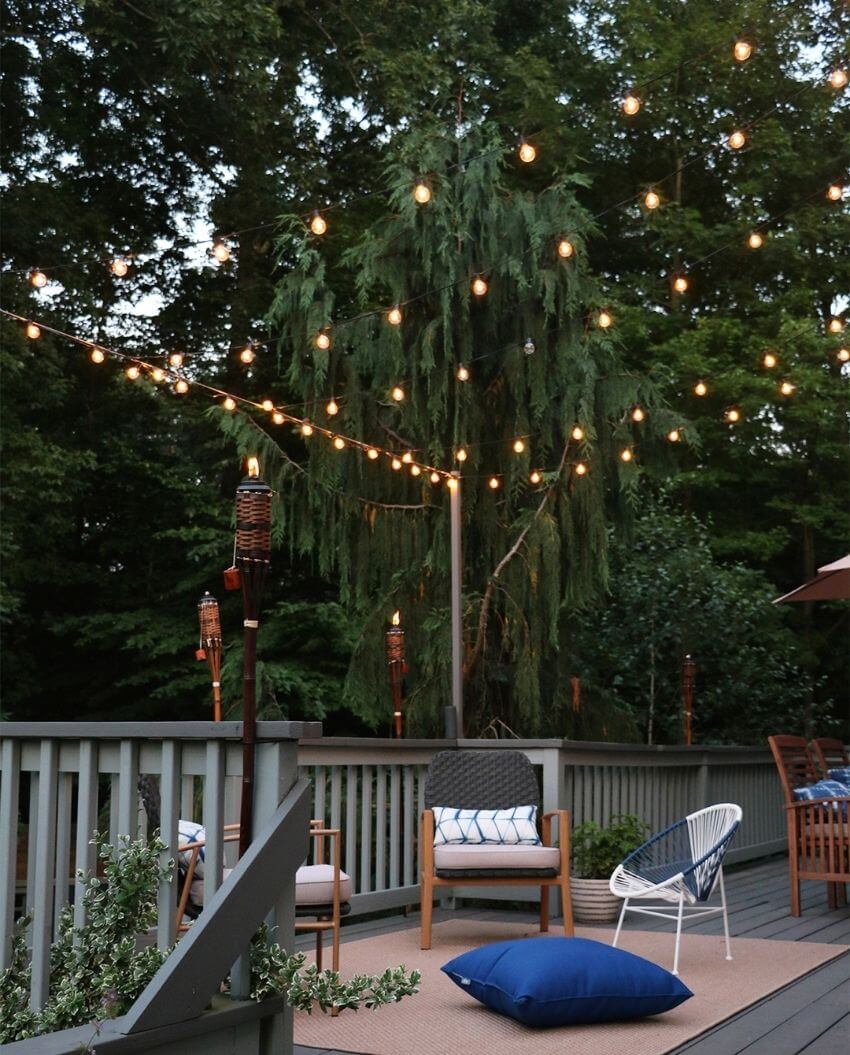 source - rootanddwell.com/ Outdoor spaces and string lights are a pair made in summertime heaven!  Here are some magical summertime string light spaces to make you smile! #outdoorstringlights #outdoorstringlightsideas #stringlights #outdoorsummerstringlights #summerstringlights #tulipandsage