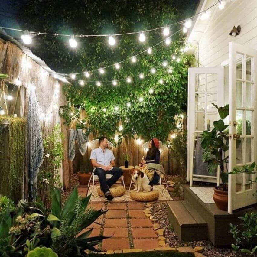 source - weddingchicks.com/ Outdoor spaces and string lights are a pair made in summertime heaven!  Here are some magical summertime string light spaces to make you smile! #outdoorstringlights #outdoorstringlightsideas #stringlights #outdoorsummerstringlights #summerstringlights #tulipandsage